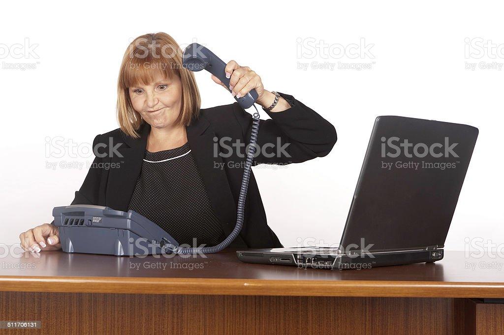 Businesswoman slamming down telephone receiver stock photo