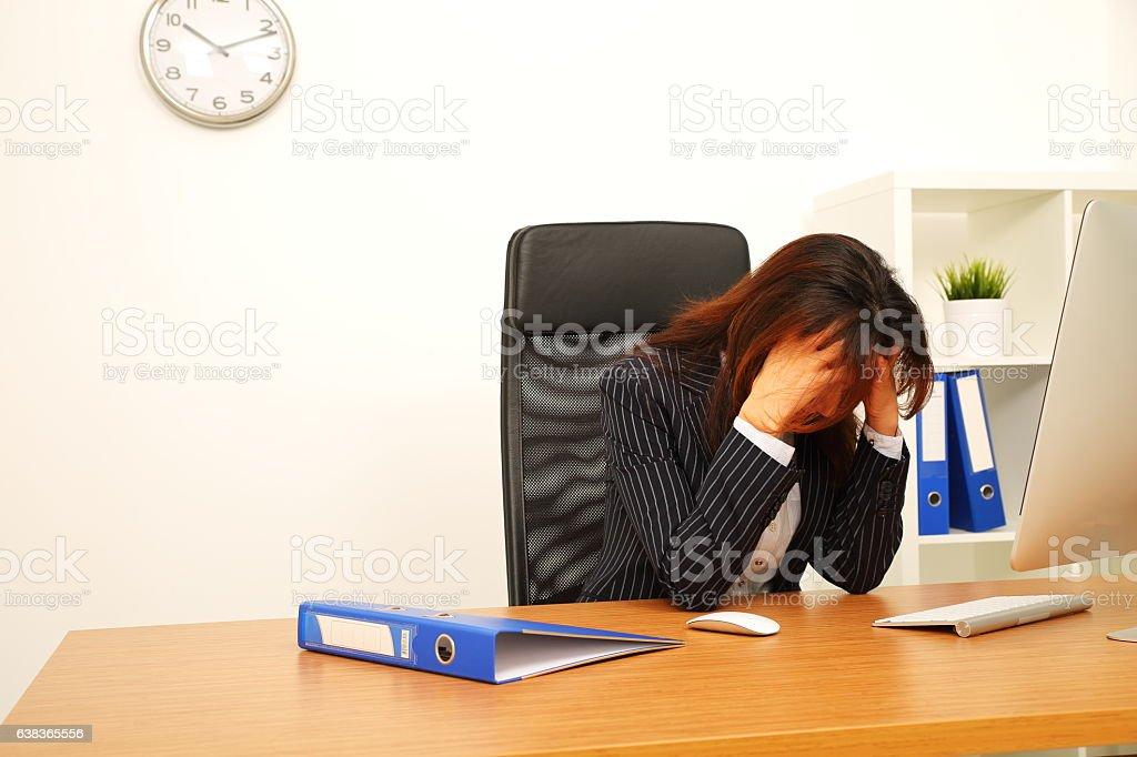 Businesswoman sleeping on desk stock photo