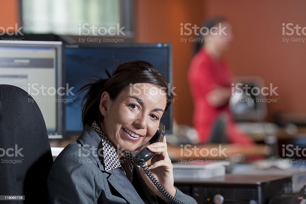 Businesswoman Smiling and Talking on a Phone royalty-free stock photo