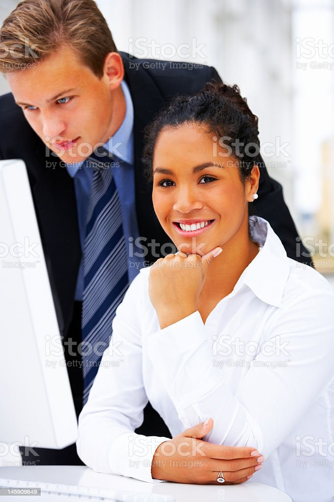 Businesswoman smiling beside a businessman royalty-free stock photo