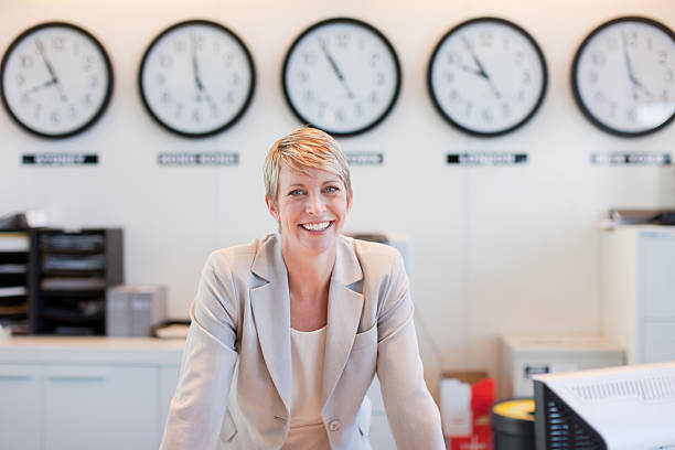 Businesswoman smiling in office stock photo