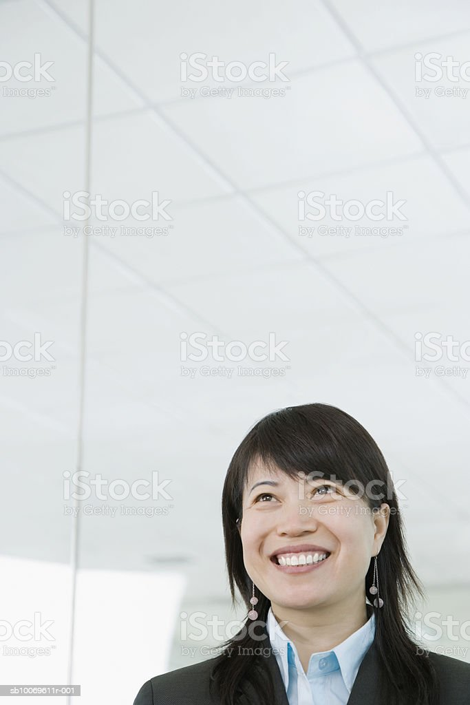 Businesswoman smiling, looking away royalty-free stock photo