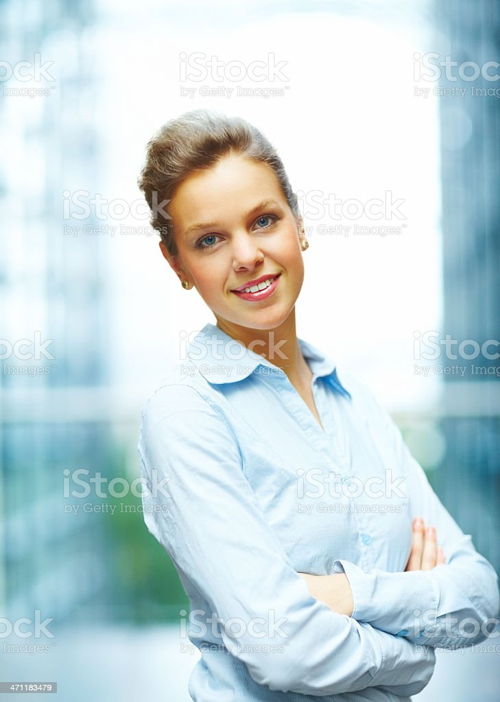 Businesswoman smiling with her arms crossed royalty-free stock photo