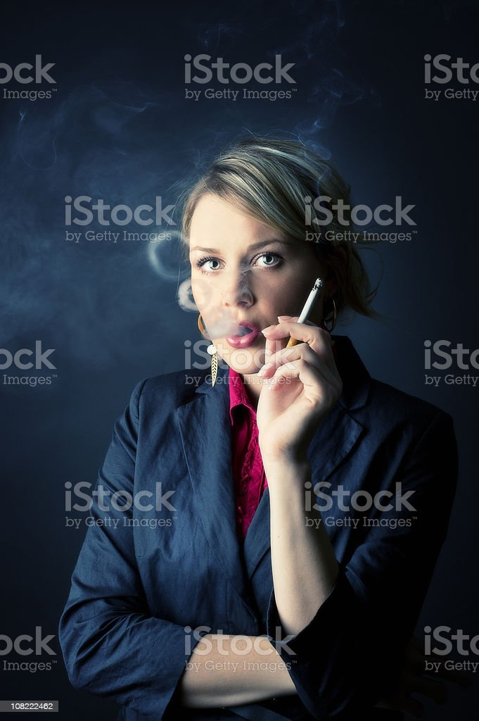 Businesswoman Smoking Cigarette royalty-free stock photo