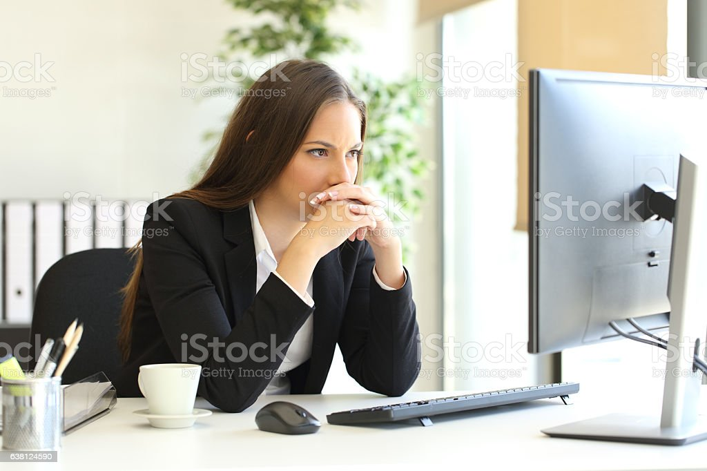 Businesswoman solving a difficult assignment stock photo