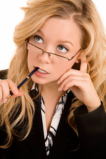 Businesswoman Solving a Problem A businesswoman is trying to solve a problem dazzled stock pictures, royalty-free photos & images