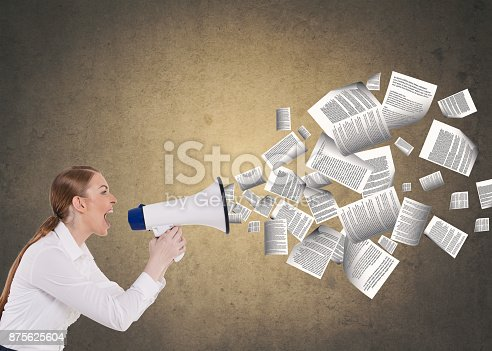 903659714istockphoto Businesswoman speaking on megaphone 875625604