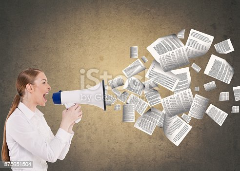 903659714istockphoto Businesswoman speaking on megaphone 875651504