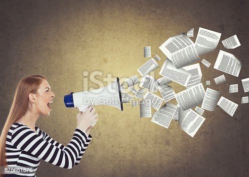 903659714istockphoto Businesswoman speaking on megaphone 875651576