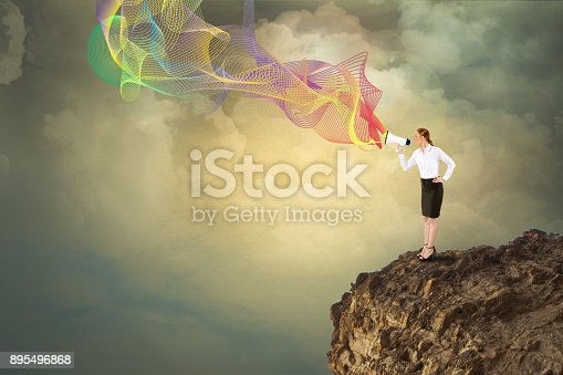 istock Businesswoman speaking on megaphone 895496868