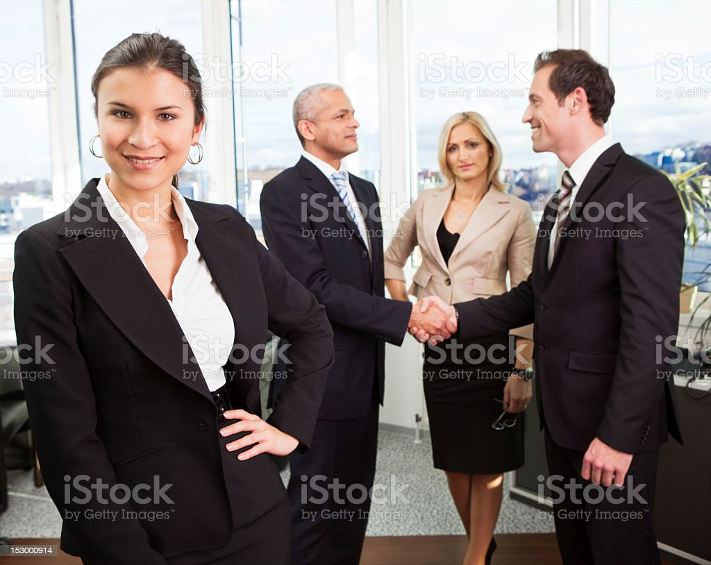 Businesswoman standing in front royalty-free stock photo