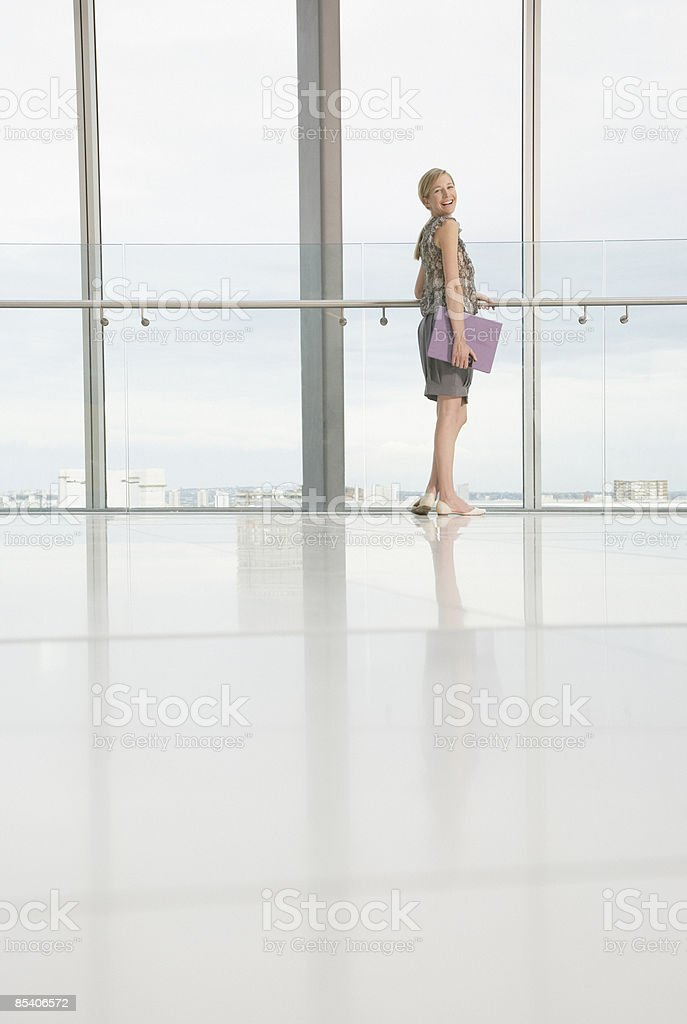 Businesswoman standing in modern lobby royalty-free stock photo