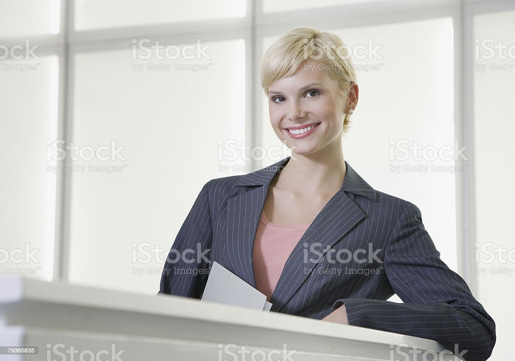 Businesswoman standing in office looking at camera 免版稅 stock photo
