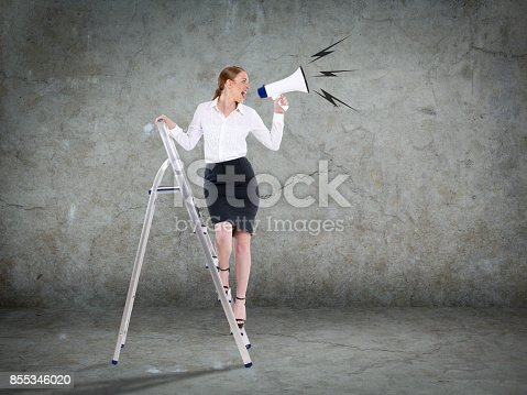 istock Businesswoman standing on ladder and holding megaphone 855346020