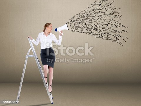 istock Businesswoman standing on ladder and holding megaphone 855346372