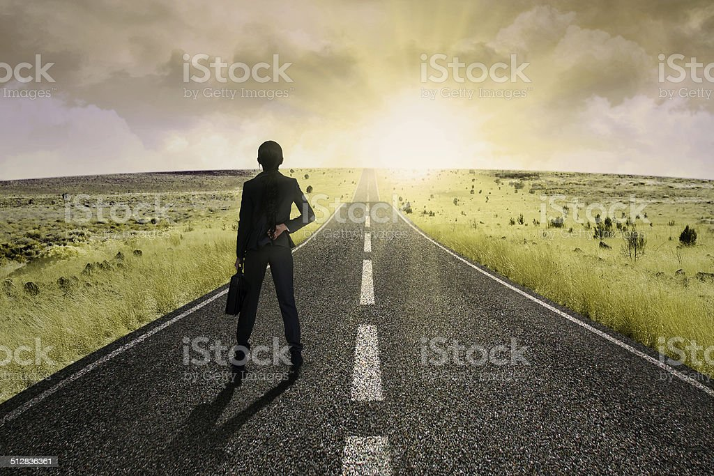 Businesswoman standing on the highway road 1 stock photo