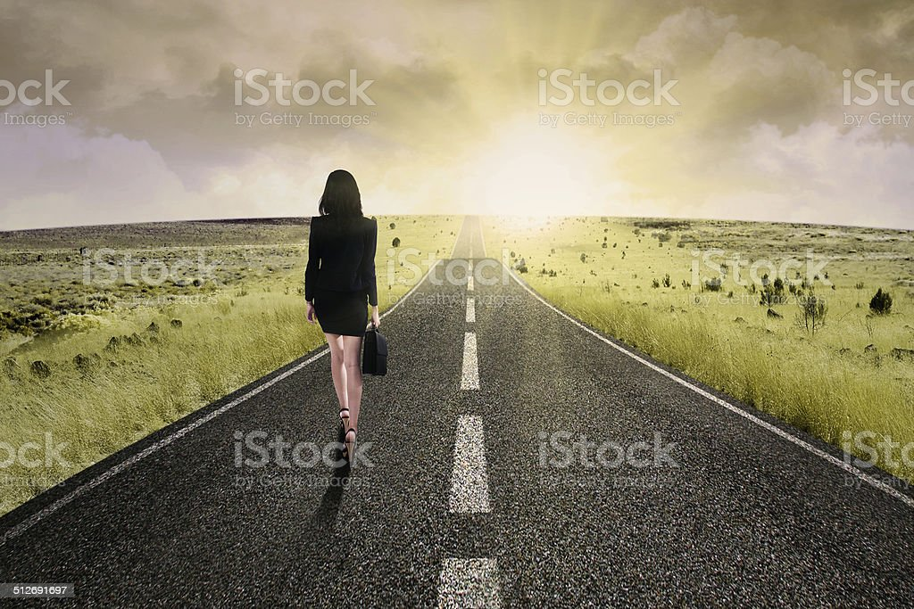 Businesswoman standing on the highway road 2 stock photo