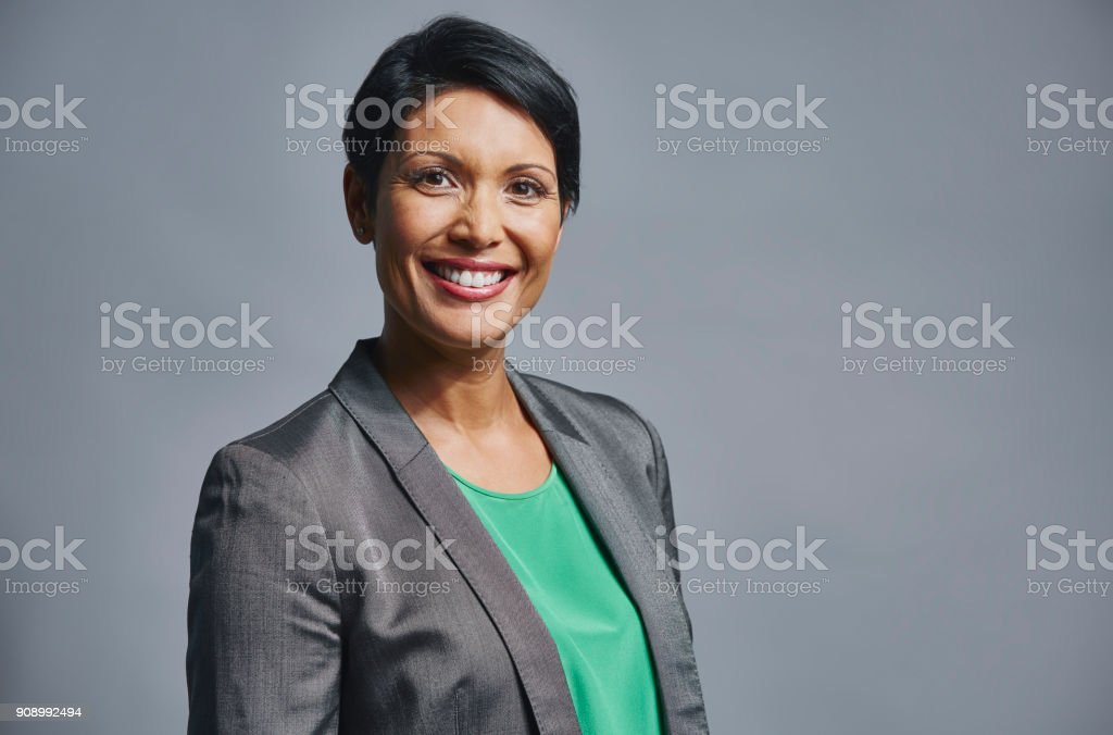Businesswoman standing over gray background stock photo
