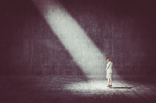 Businesswoman Standing Under The Spotlight Stock Photo - Download Image Now