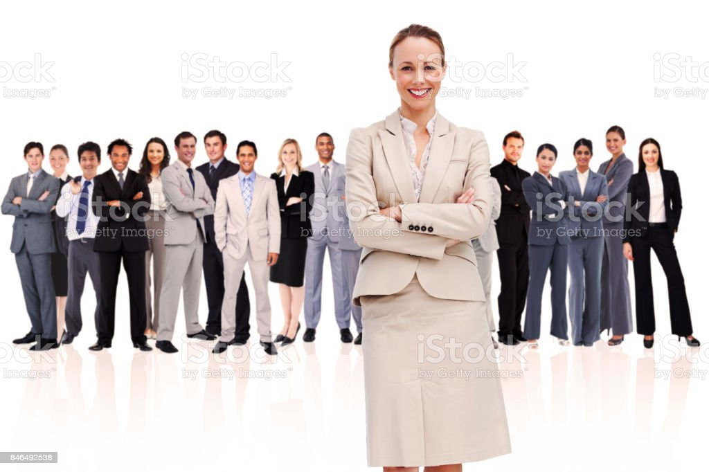 Businesswoman standing up in foreground stock photo