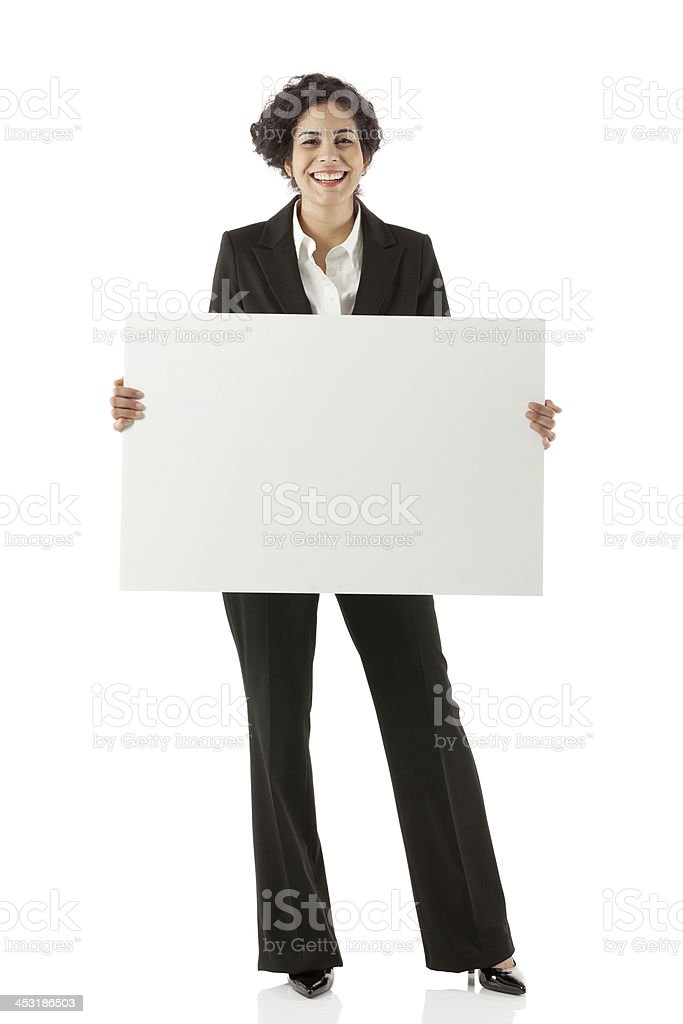 Businesswoman standing with a placard royalty-free stock photo