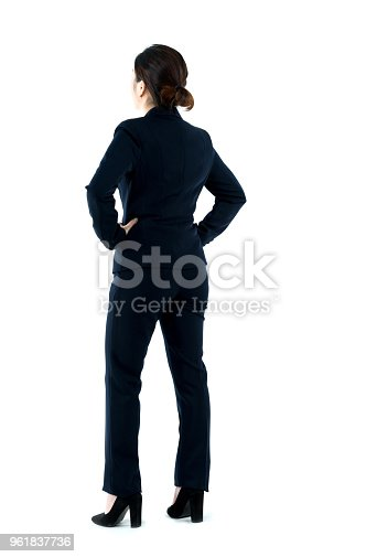 istock Businesswoman standing with arms akimbo 961837736