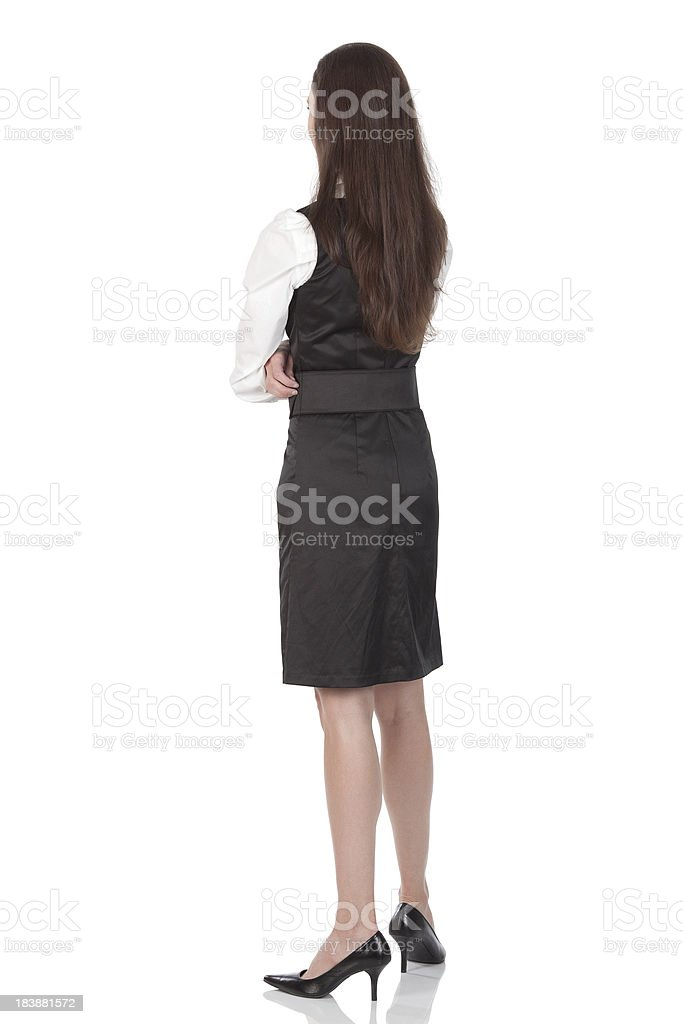 Businesswoman standing with arms crossed royalty-free stock photo