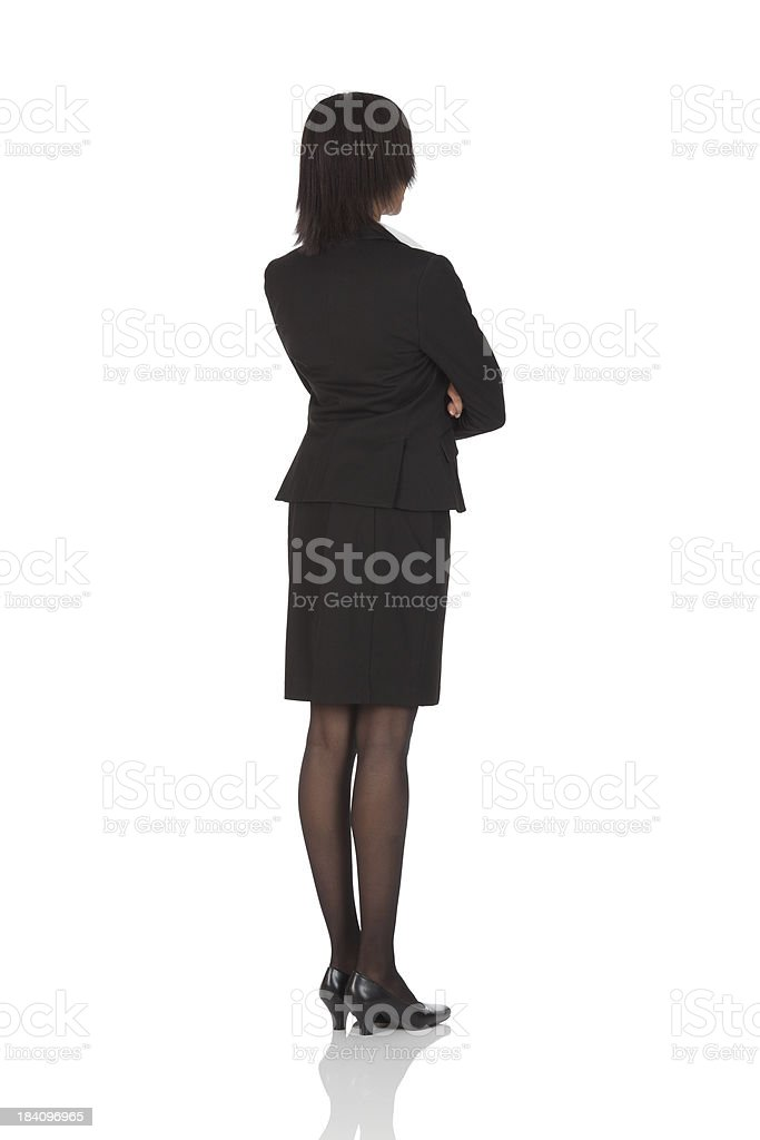Businesswoman standing with arms crossed stock photo