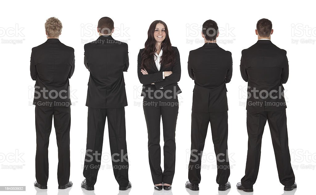 Businesswoman standing with businessmen stock photo
