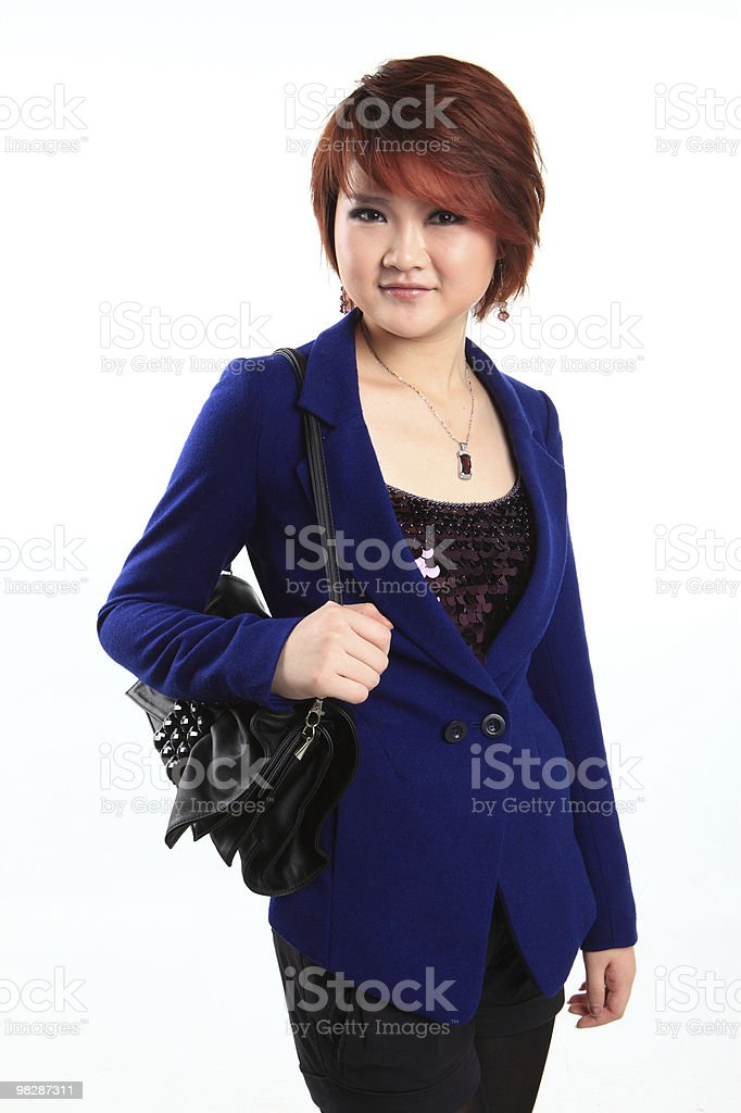 Businesswoman standing with handbag royalty-free stock photo