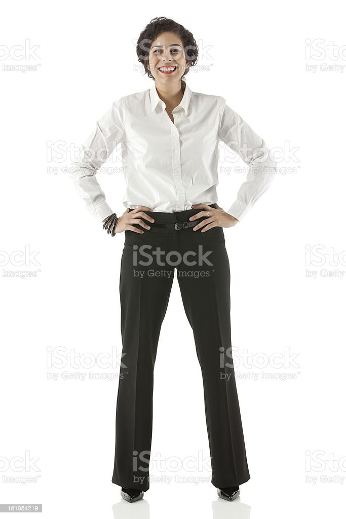 Businesswoman standing with hands on hip stock photo