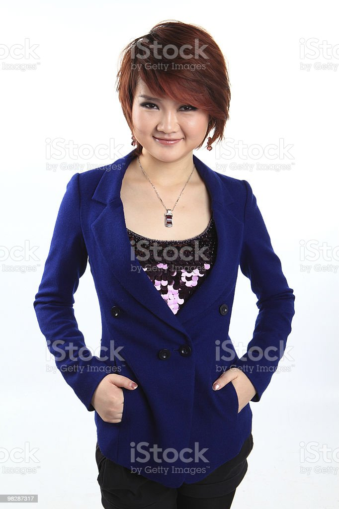 Businesswoman standing with hands on hips against white background royalty-free stock photo