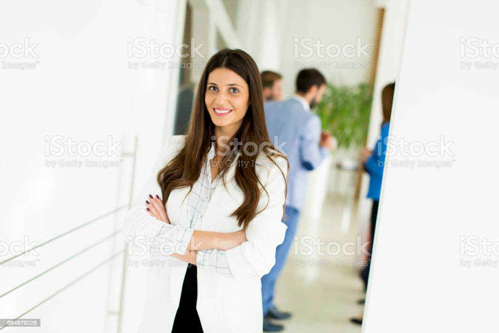 Businesswoman standing with her arms crossed Lizenzfreies stock-foto