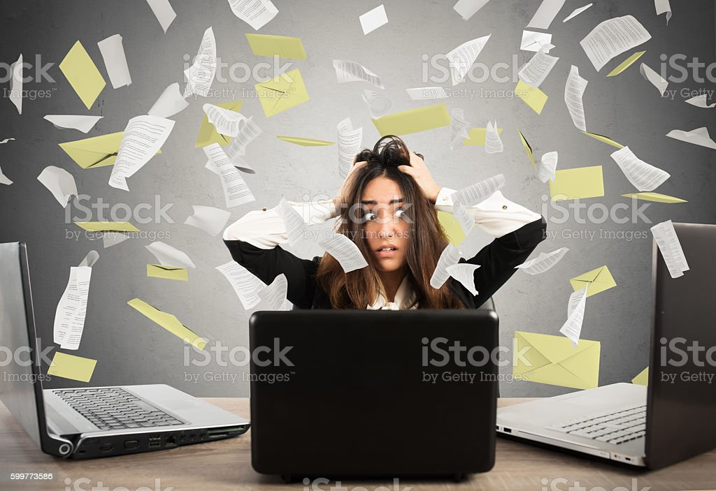 Businesswoman stressed by spam stock photo