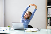 istock Businesswoman Stretching Her Arms 1042650418