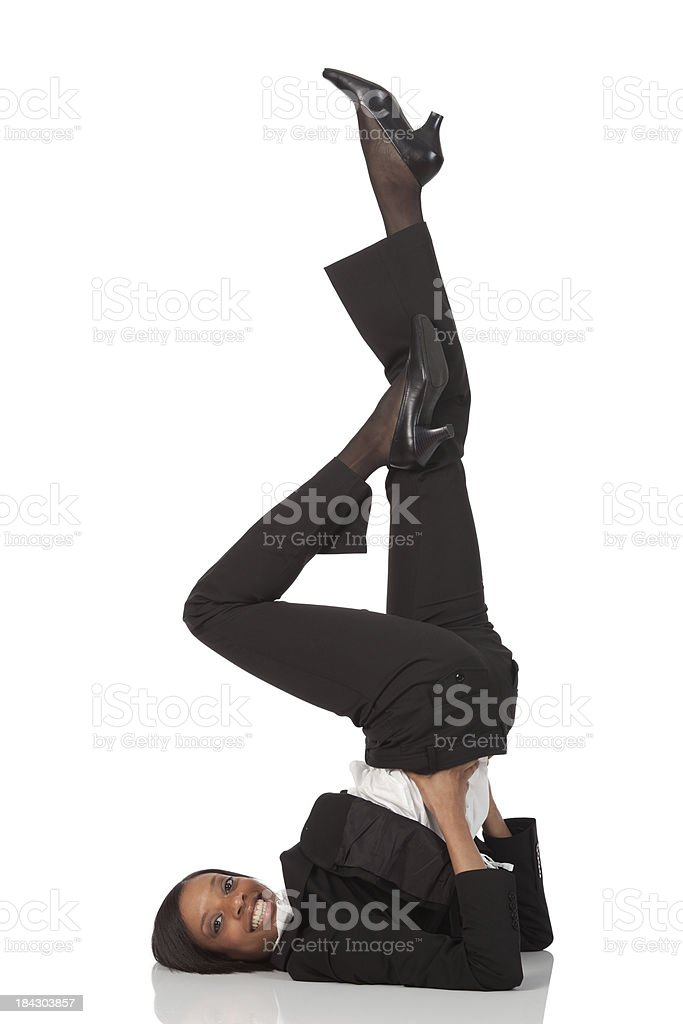 Businesswoman stretching her legs royalty-free stock photo