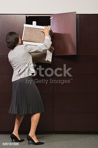istock Businesswoman struggling with files 535167005