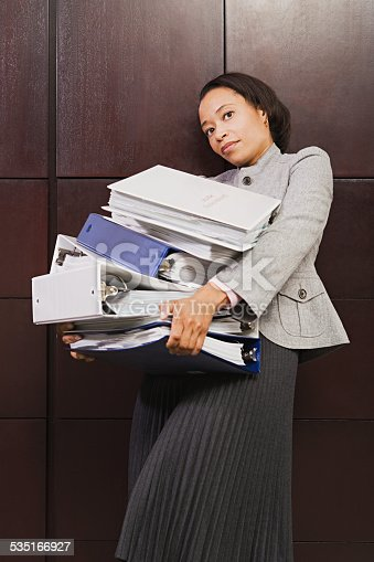 1067846662 istock photo Businesswoman struggling with heavy files 535166927