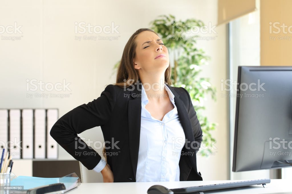 Businesswoman suffering back ache stock photo