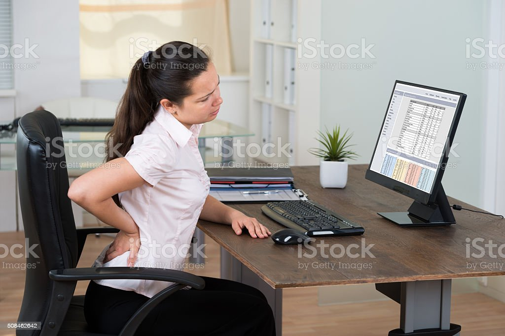 Businesswoman Suffering From Backache stock photo