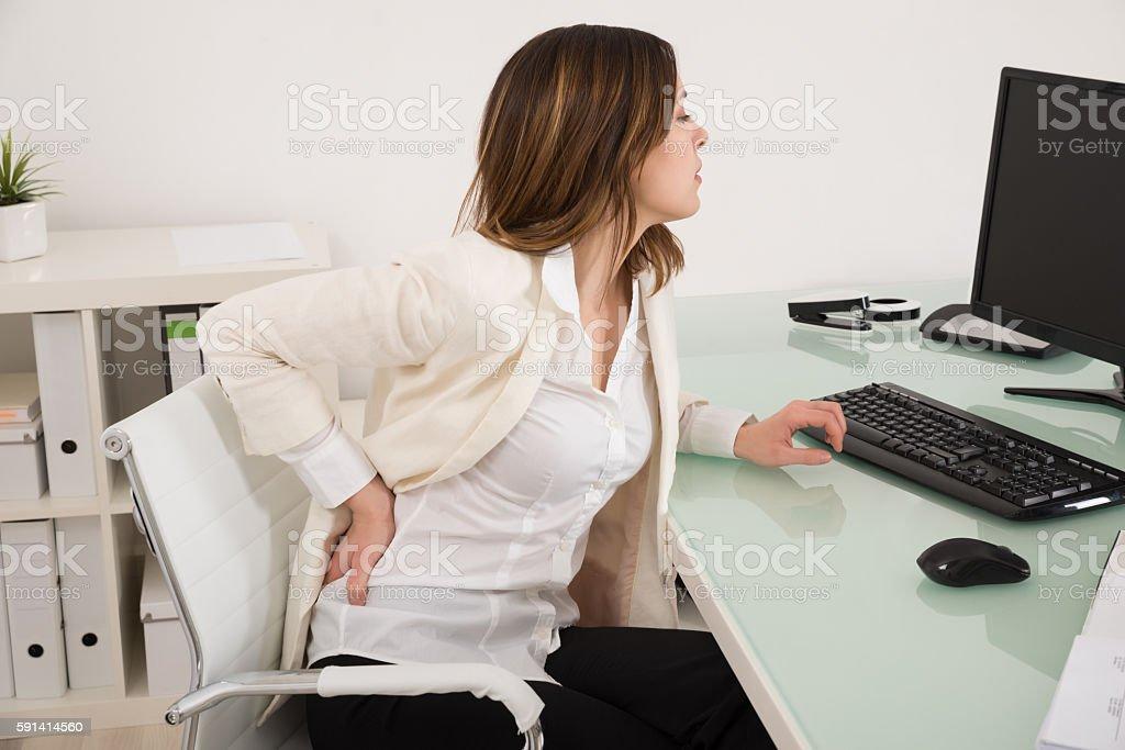 Businesswoman Suffering From Backache stock photo