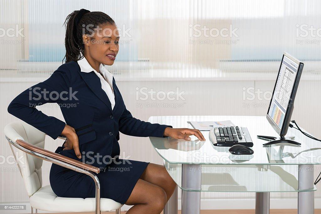 Businesswoman Suffering From Backache Portrait Of A Young African Businesswoman Suffering From Backache Adult Stock Photo
