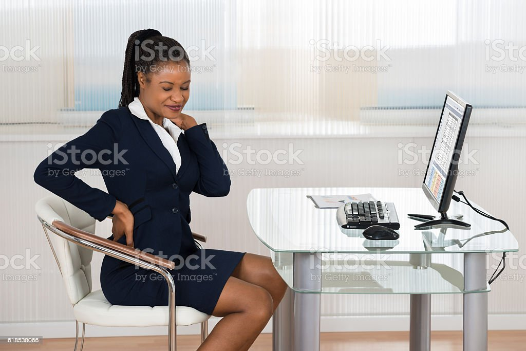Businesswoman Suffering From Neckache stock photo