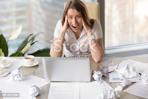 692461598 istock photo Businesswoman suffering from nervous breakdown 681625394