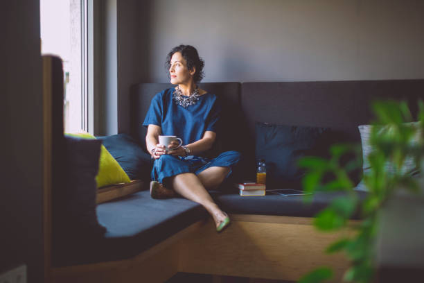 businesswoman taking a break - deliberation stock pictures, royalty-free photos & images