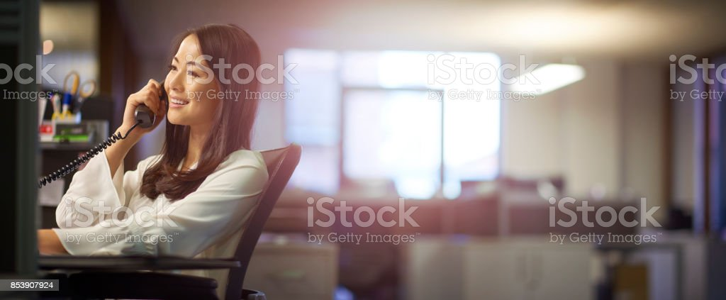businesswoman taking a call stock photo