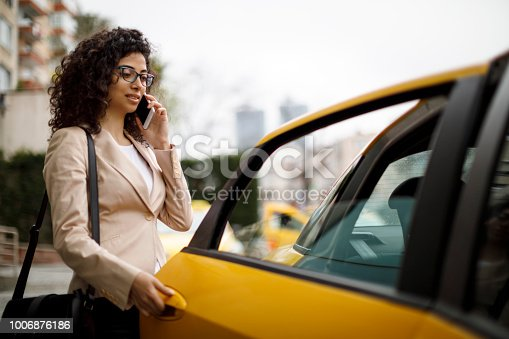 Businesswoman taking a taxi ride