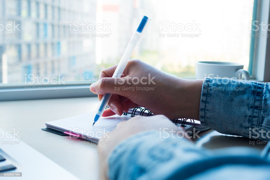 Businesswoman taking business notes stock photo