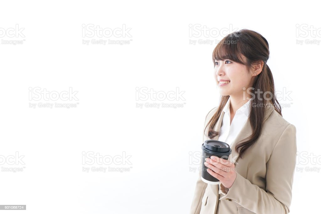 Businesswoman taking out coffee stock photo