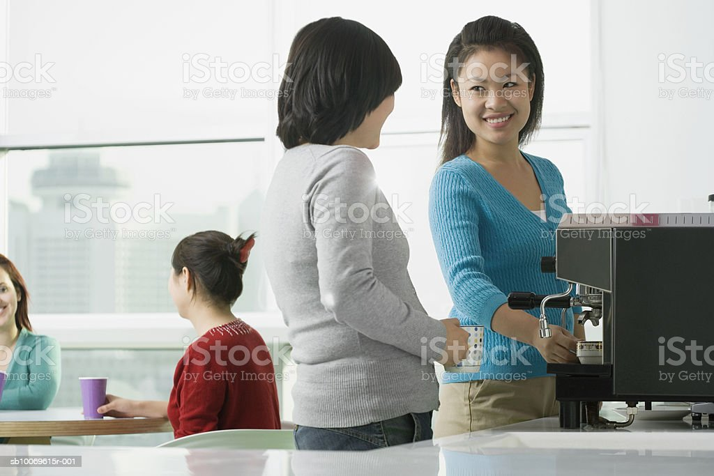 Businesswoman taking with her colleague in cafeteria Lizenzfreies stock-foto